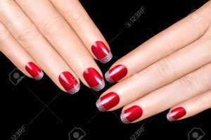 31945700-Holiday-Nail-Art-Luxury-nail-polish-with-glitter-French-manicure-Manicure-and-makeup-concept-Closeup-Stock-Photo